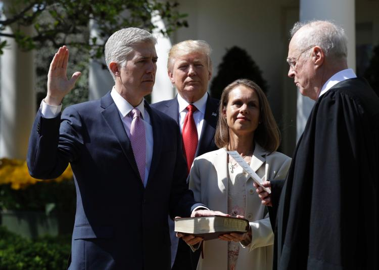 Gorsuch sworn into Supreme Court, vows to serve the law